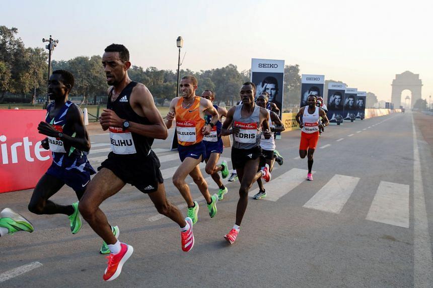 Elite runners take part in the Airtel Delhi Half Marathon on Nov 29, 2020.