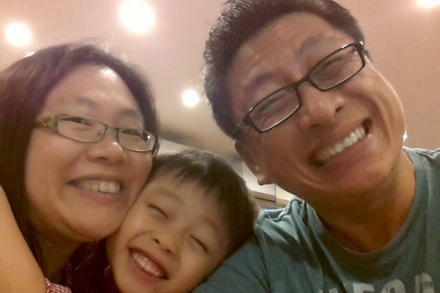 A family photo of Mrs Winnie Lee, Raphael, and Mr William Lee.