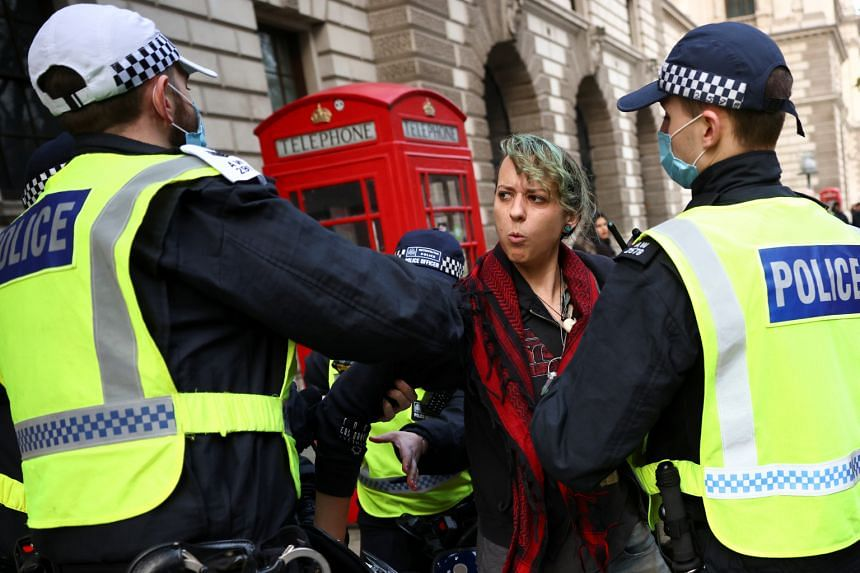 Police officers detain an anti-lockdown protester in London, on Nov 28, 2020.