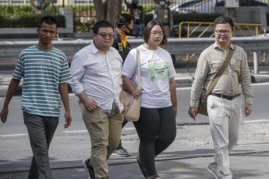 (From left) Pro-democracy activists Panupong 'Mike' Jadnok, Parit 'Penguin' Chiwarak, Panusaya 'Rung' Sithijirawattanakul and lawyer Arnon Numpa arrive at a police station in Bangkok on Nov 30, 2020.