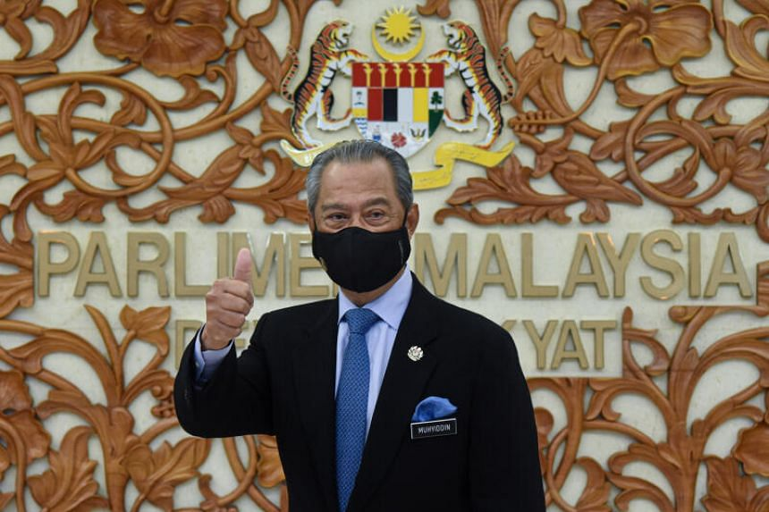 Malaysia's Prime Minister Muhyiddin Yassin poses for a picture at the parliament, in Kuala Lumpur, Malaysia on Nov 26, 2020.