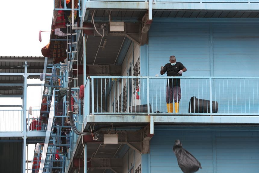 Apart from going to work or to run essential errands, workers are still largely restricted to their dorms.