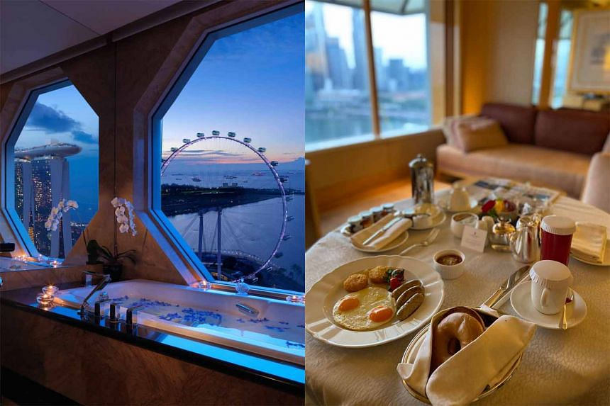The Premier Suite at The Ritz-Carlton, Millenia Singapore is the only room type with a bathroom (left) offering views of the Singapore Flyer. The American Breakfast set (right) is one of many extensive choices the hotel offers.