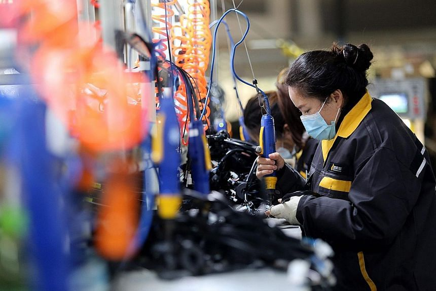 China's Purchasing Managers' Index rose to 52.1 last month from 51.4 in October as its industrial sector recovers.