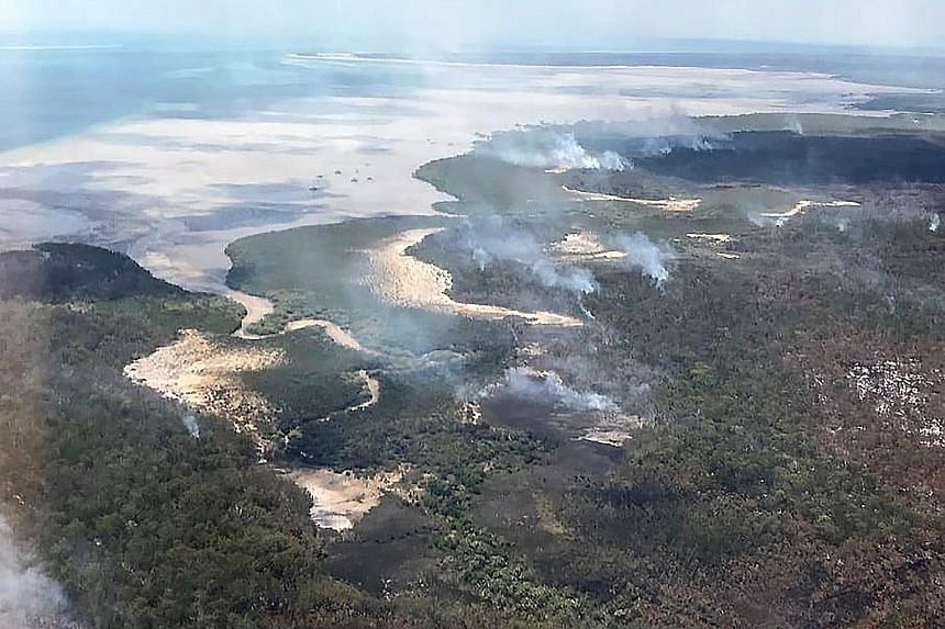 A photo from the Queensland Fire and Emergency Services showing an aerial view of bush fires on Fraser Island, off Australia's east coast. The fire on the world's largest sand island has been raging for more than six weeks and is consuming large swat