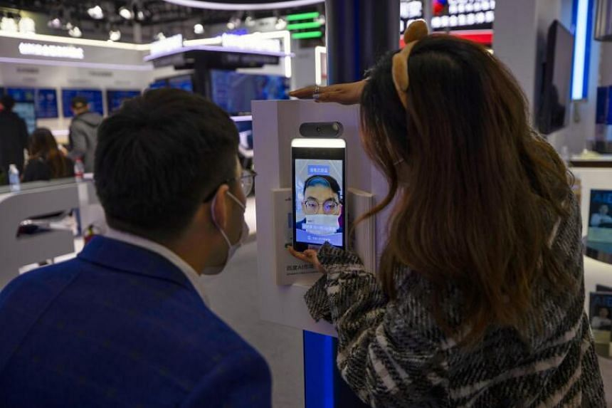 A man tries a new facial recognition with a mask feature during the World Internet Conference in Wuzhen, China on 23 Nov, 2020.