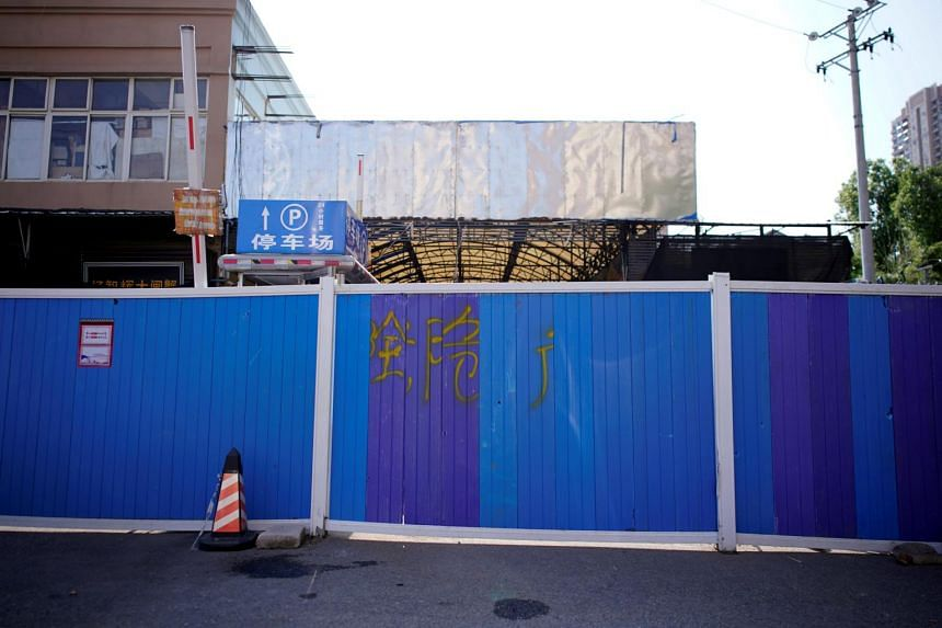 A blocked entrance to Huanan seafood market, where the coronavirus is believed to have first surfaced in Wuhan, China.