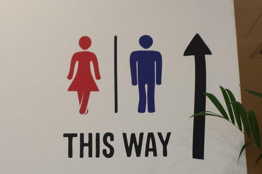 A public toilet sign outside a food court in City Square Mall.