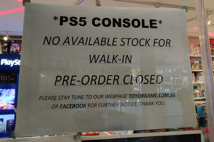 A notice (above) last week warning about the limited availability of Sony's PlayStation 5 at a store in Waterway Point, which saw shoppers queueing for the newly launched console.