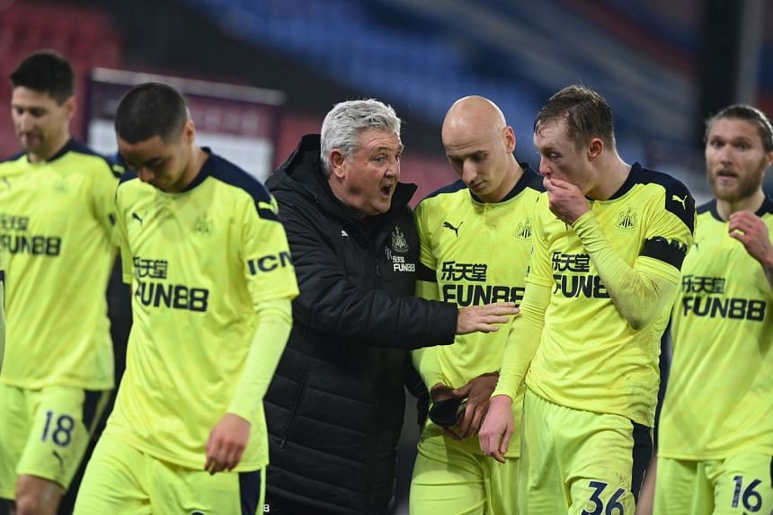 Newcastle players and manager Steve Bruce celebrate at the end of a match against Crystal Palace on Nov 27, 2020.