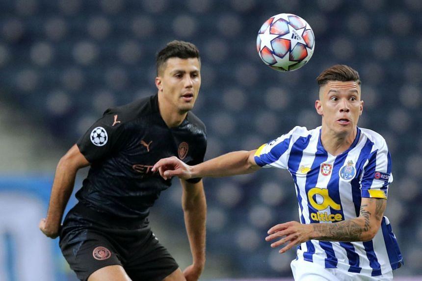 Porto's Matheus Uribe (right) in action against Manchester City's Rodri Hernandez.