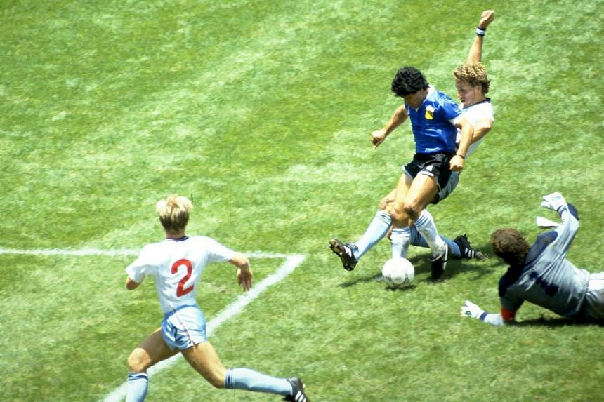 A 1986 photo shows Maradona scoring for Argentina in the World Cup quarter-final against England.