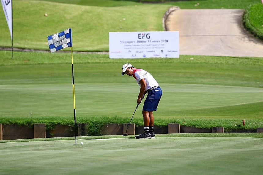 Brandon Han putting at the EFG Singapore Junior Masters at Laguna's Masters Course. As part of Covid-19 measures, golfers are not allowed to remove the flagsticks.