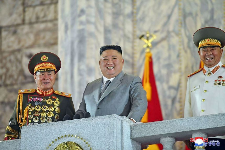 North Korean leader Kim Jong Un (centre) attends a military parade in Pyongyang.