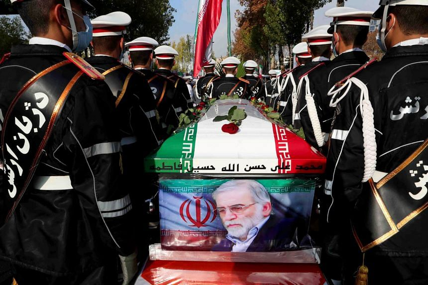 Iranian forces carry the coffin of Iranian nuclear scientist Dr Mohsen Fakhrizadeh during a funeral ceremony in Tehran, Iran, on Nov 30, 2020.