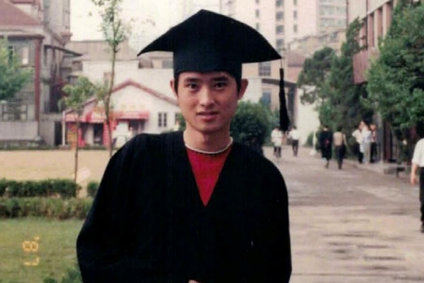 Former actor Ren Quan posing in his graduation gown at the Shanghai Theatre Academy.