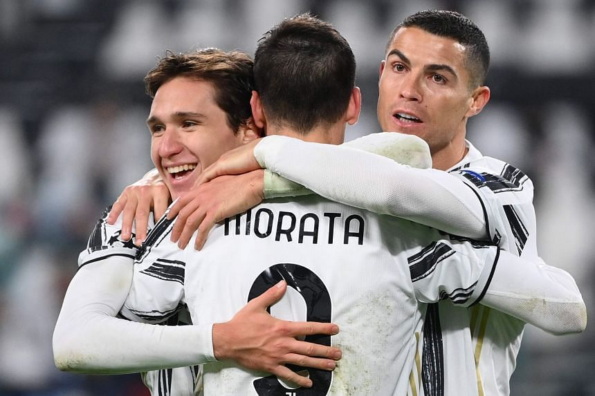Morata (centre) celebrates his goal with Federico Chiesa (left) and Cristiano Ronaldo.