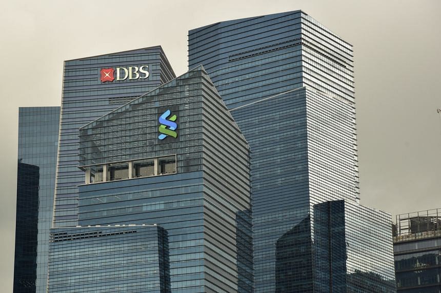 DBS will cut rates on its flagship DBS Multiplier deposit account and StanChart will cut its interest rate for JumpStart.