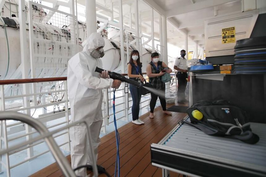 Those boarding the Royal Caribbean cruise had their boarding passes scanned and suitcases underwent a disinfection process called electrostatic fogging.