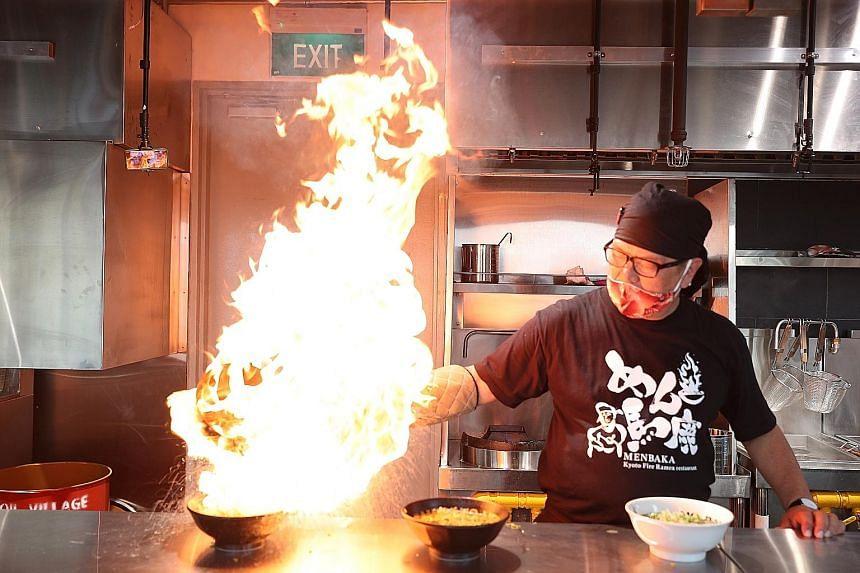 Mr Masamichi Miyazawa (above), founder of Menbaka Fire Ramen, preparing the Fire Ramen.