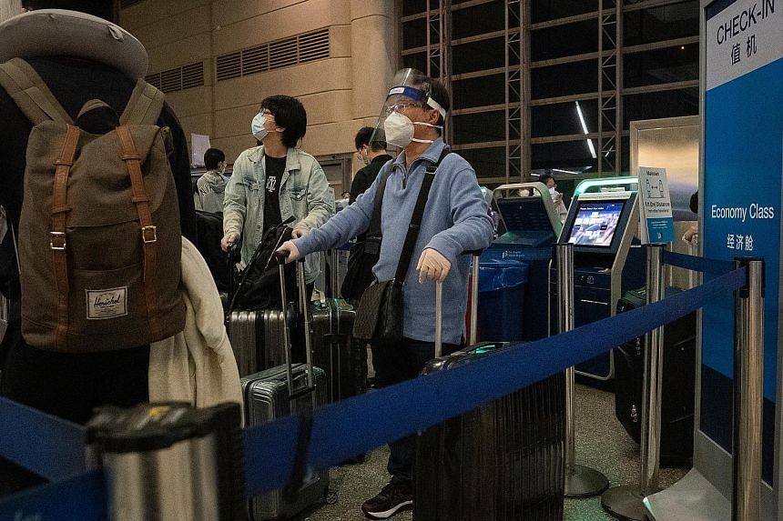 Travellers waiting to check in for a China Southern Airlines flight at Los Angeles International Airport on Nov 23. The Trump administration on Wednesday issued rules to restrict travel to the United States by Chinese Communist Party members and thei
