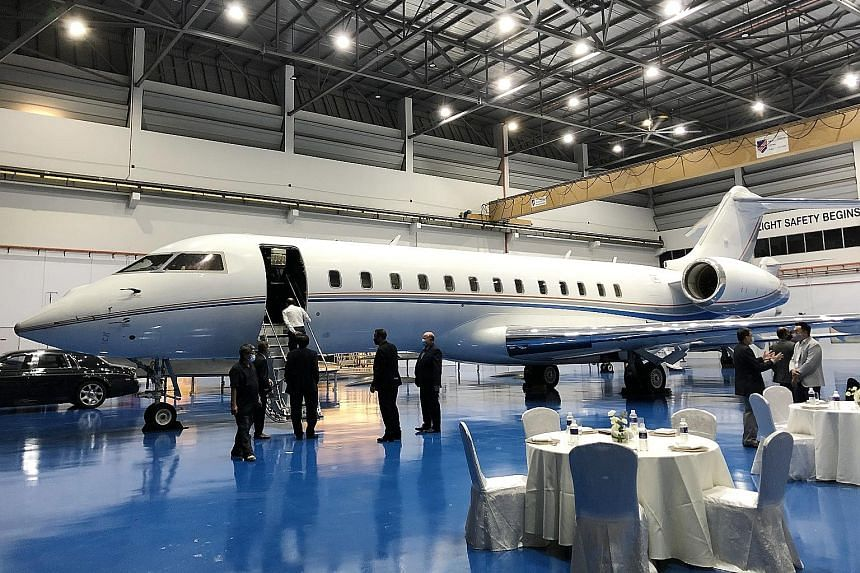 A plane at Kelley Aerospace's hangar in Seletar Aerospace Park, its first facility in Singapore. The American firm is launching three programmes here, one of which involves buying 100 aircraft that will fly private clients around the world. ST PHOTO: