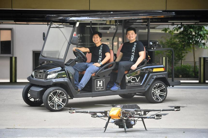 Co- founders of Spectronik, Zarli Maung Maung (left) and Jogjaman Jap with the hydrogen FC-powered golf cart and drone.