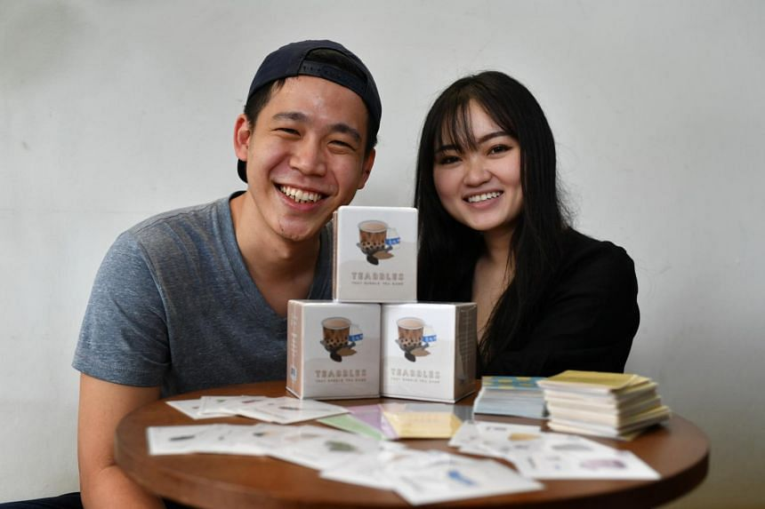 Aaron Tan and his wife Jolene Yang with their bubble tea-themed card game, Teabbles.