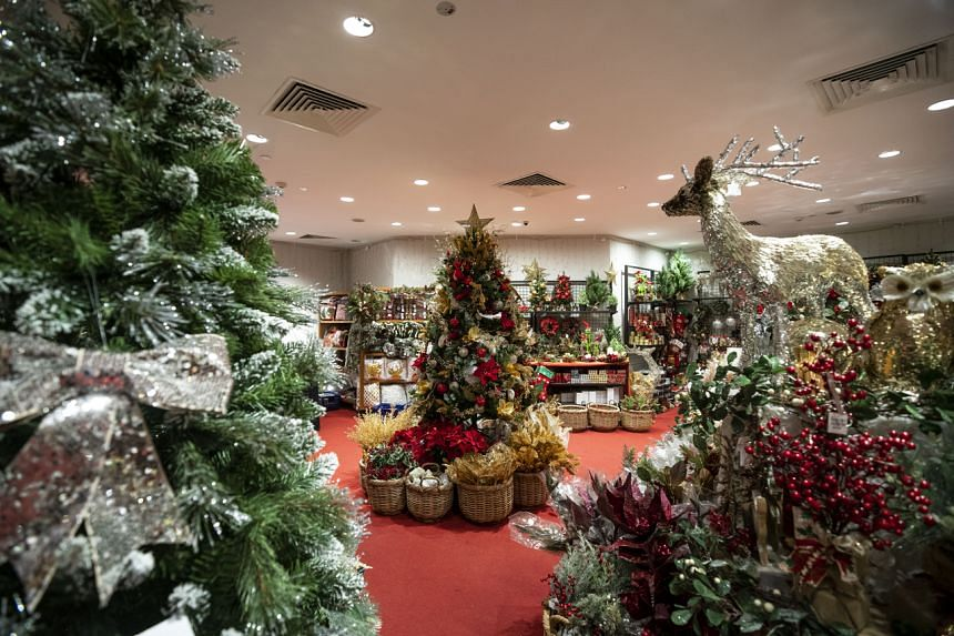 Stores which sell trees - both real and artificial - are doing brisk business.