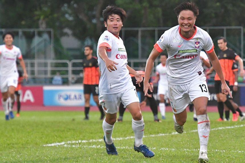 Albirex Niigata's Ryoya Taniguchi (right) celebrates after scoring against Hougang United.