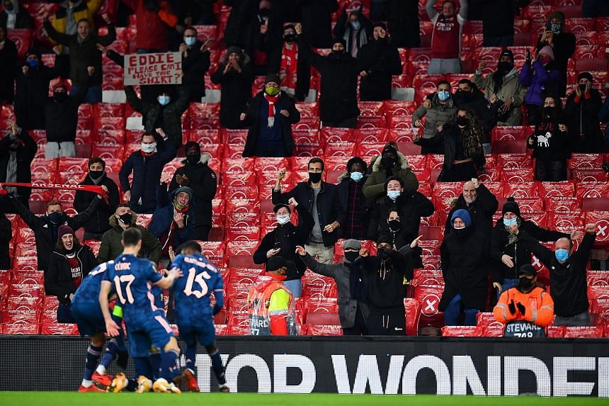 Striker Alexandre Lacazette celebrating Arsenal's first goal in front of fans since March on Thursday. His 10th-minute strike against Rapid Vienna started the ball rolling and the Gunners sent their supporters home happy with a 4-1 win.