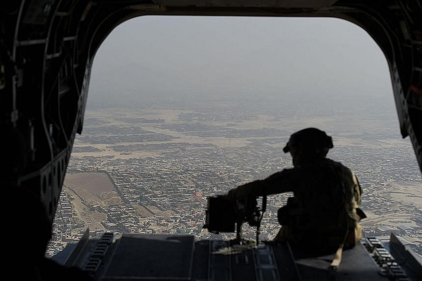 A US Chinook helicopter flying over Kabul in 2017. Beijing may now be enjoying America's withdrawal from Afghanistan, but it is the one that is most likely to feel the longer-term repercussions, says the writer.