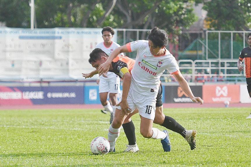 Albirex Niigata's Tomoyuki Doi and Hougang United's Fabian Kwok in action.