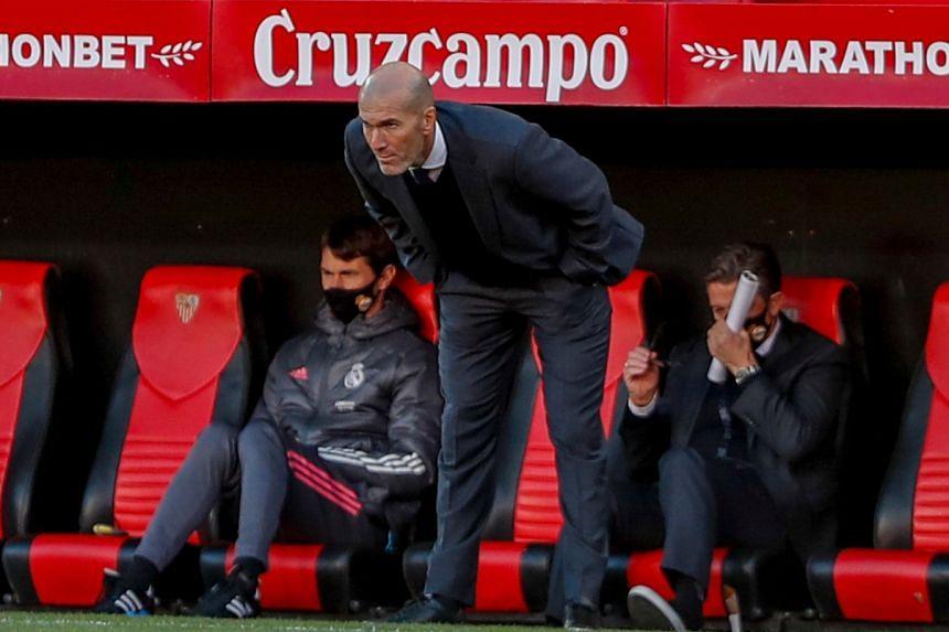 Zidane watches Real's match aginst Sevilla.