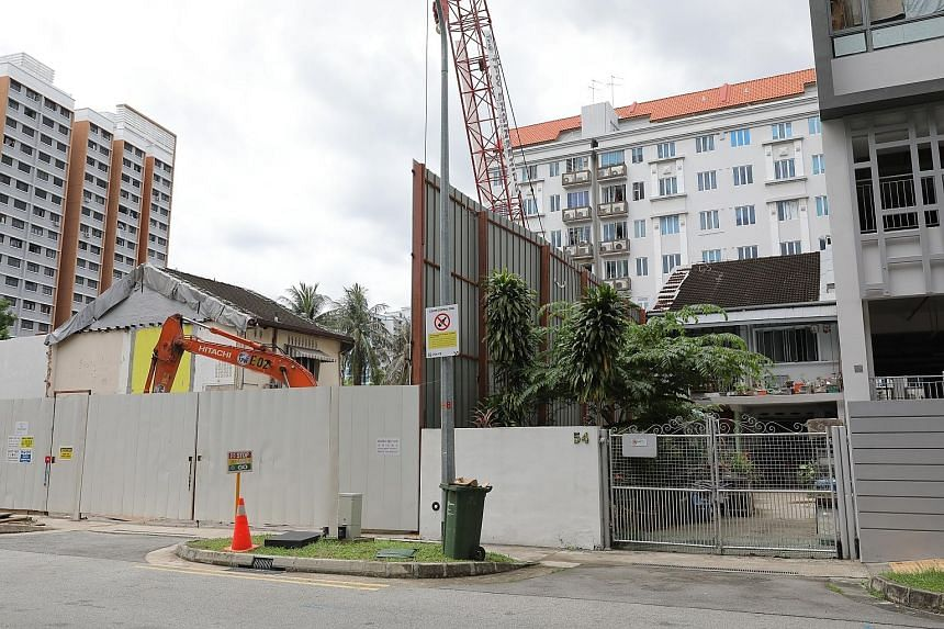 The house at 337 Guillemard Road surrounded by the upcoming NoMa condo on three sides. Developer Macly Group had intended to acquire seven two-storey terraced houses in the vicinity, but it managed to convince only five of the owners to sell their pr