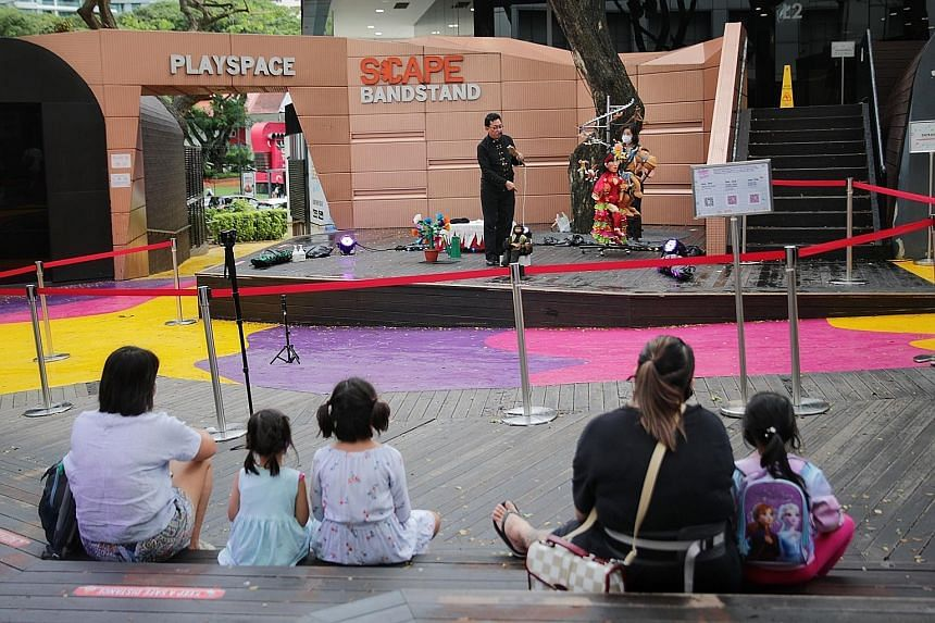 Ventriloquist and magician Patrick Wan performing at *Scape yesterday. The 62-year-old said he was excited to be performing for a live audience again after nine months, and that virtual shows cannot compare with real life. The trial busking scheme be