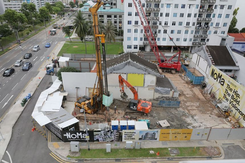 337 Guillemard Road (centre of image) and 54 Lorong 28 Geylang (right) amidst the construction of NoMa condominium.