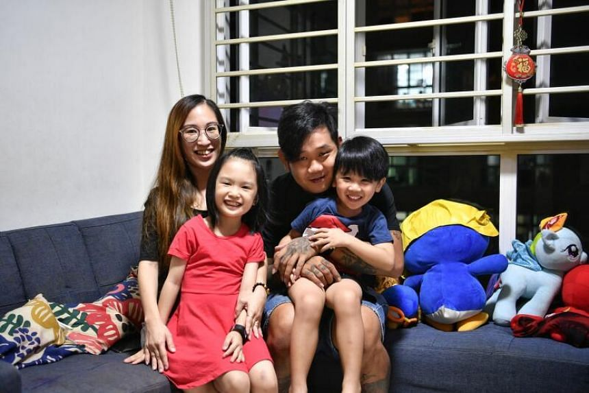 Madam Bernice Sum and her husband Roger Chua with their children. Madam Sum's son will be entering Primary 1.