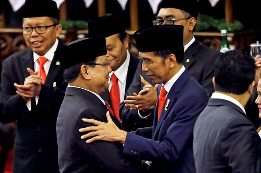 Indonesian President Joko Widodo is congratulated by the Gerindra Party Chairman Prabowo Subianto after his presidential inauguration for the second term on Oct 20, 2019.