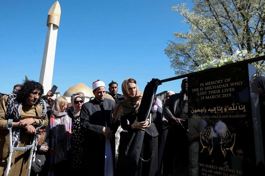 New Zealand's Prime Minister Jacinda Ardern (centre) unveiling a plaque at the mosque in memory of the victims killed in the 2019 twin mosque shootings.