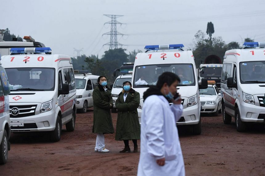 Rescue personnel wait beside parked ambulances outside the Diaoshuidong coal mine in southwestern China's Chongqing on Dec 5, 2020.