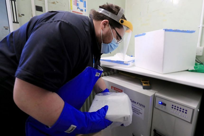 A pharmacy technician takes delivery of the first batch of Covid-19 vaccinations at Croydon University Hospital in south London on Dec 5, 2020.