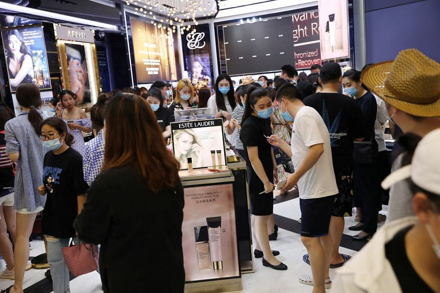 People shopping at a cosmetics store inside the Sanya International Duty-Free Shopping Complex, on Nov 25, 2020.