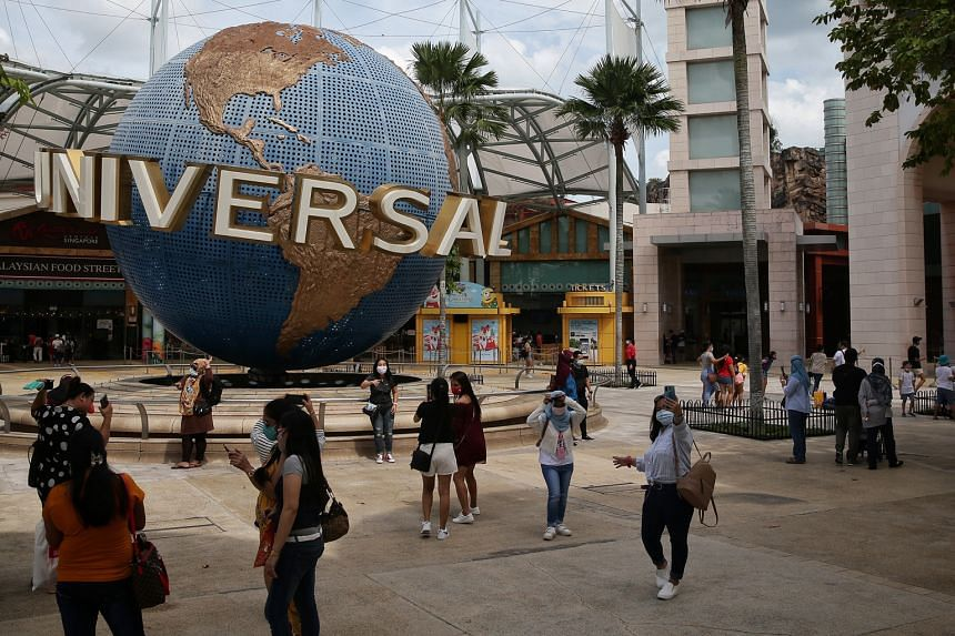 Visitors outside Universal Studios Singapore yesterday. Booking platforms told The Straits Times that they are seeing a healthy uptake across the board, in particular for visitor magnets like Gardens by the Bay and Universal Studios Singapore.