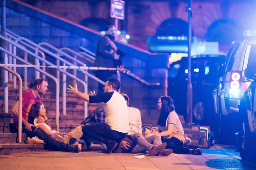 Wounded concert-goers after a suicide bomb blast at the end of a concert by Ariana Grande at Manchester Arena, on May 22, 2017.