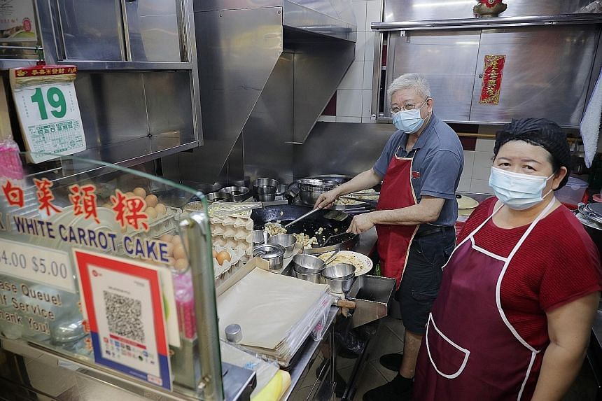 Mr Christopher Lau, owner of Bakes n Bites, with a Nets terminal at his stall in Old Airport Road Food Centre. A recent visit showed that 80 per cent of all the hawkers there use a payment QR code or a Nets terminal. Mr Don Eng, owner of Pasta Manna,