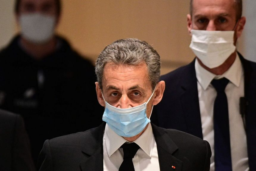 Former French president Nicolas Sarkozy (centre) arrives for a hearing of his trial on corruption charges in Paris, on Dec 7, 2020.