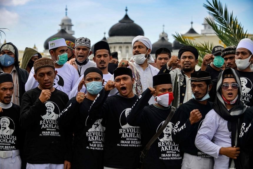 Supporters of Rizieq Shihab gather in a show of support for the firebrand cleric in front of the Baiturrahman grand mosque in Banda Aceh on Dec 8, 2020.