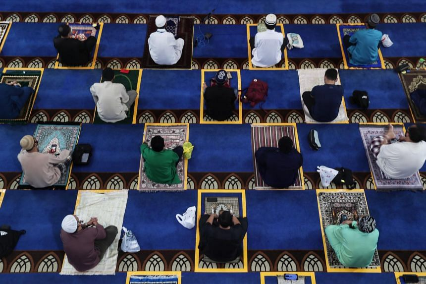 A photo taken on June 26, 2020, showing people taking part in Friday prayers at Al-Istighfar Mosque.