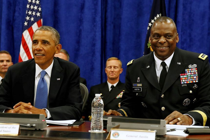 General Lloyd Austin (right) oversaw US forces in the Middle East under former president Barack Obama.